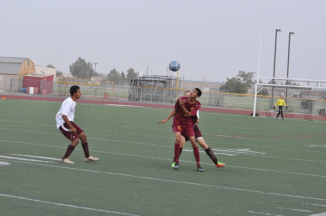 Horace Langford Jr./Pahrump Valley Times - The Pahrump Valley High School Trojans boys soccer team played right through the dust storm. They would kick the ball and the wind would carry it and ins ...