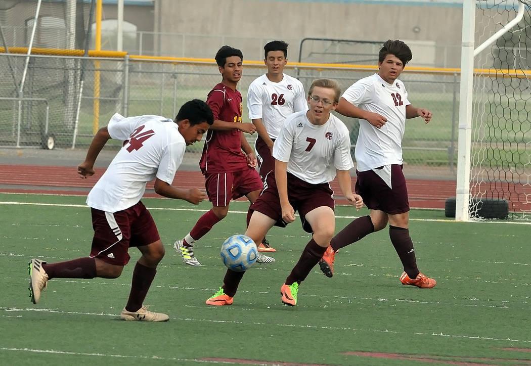 Horace Langford Jr./Pahrump Valley Times Logan Dykstra and Christian Gonzalez go for the ball on Wednesday against Del Sol. The Trojans lost their home opener 8-1.