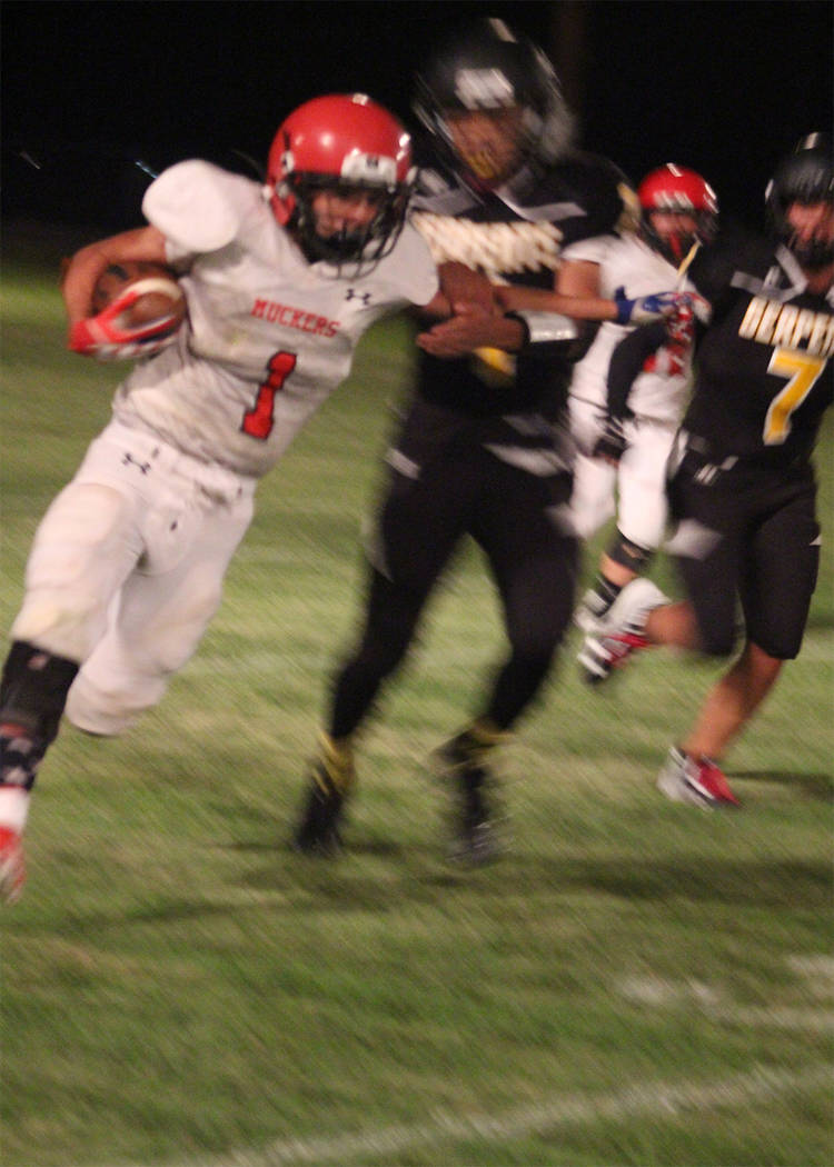 Penny Otteson/Special to the Times-Bonanza & Goldfield News John Shiflet finds some open ground against Mineral County on Friday. Shiflet had 233 yards, which was nearly half of the total offense.