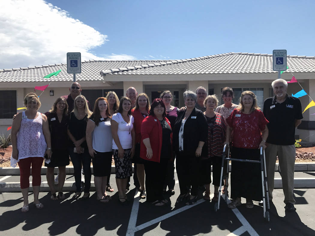 Lisa Bond Real Estate Lisa Bond of Lisa Bond Real Estate stands with her team on Aug. 24, when the group celebrated moving to a new location with a ribbon cutting and and open house. Bond is also  ...