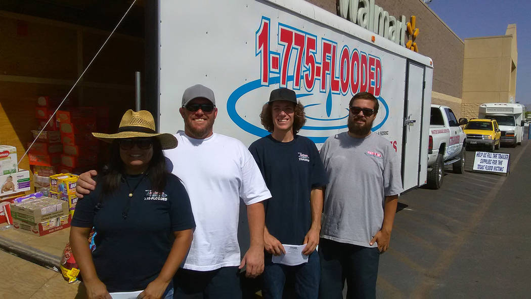 Selwyn Harris/Pahrump Valley Times  1-775 Flooded owner Trevor Maxwell, second from left, stands alongside Jessica Cabrera Jake Boehm and Thomas Townley. The four left for south Texas on Monday to ...
