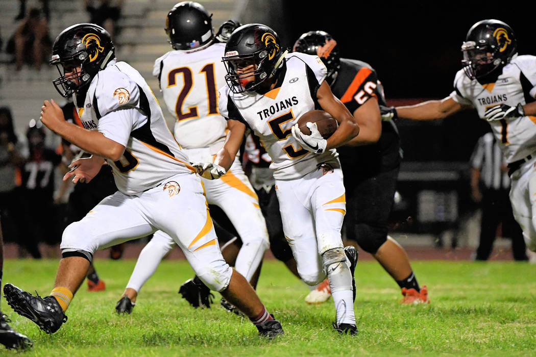 Peter Davis/Special to the Pahrump Valley Times Senior Jacob Sawin, lead rusher for the Trojans, makes his way upfield on Friday against Chaparral. He had 39-yards rushing that game.