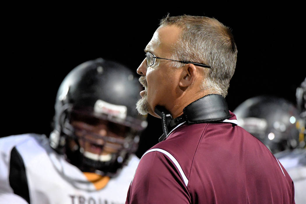 Peter Davis/Special to the Pahrump Valley Times Trojans football coach Joey Clayton looking for a weakness in the Chaparral defense.