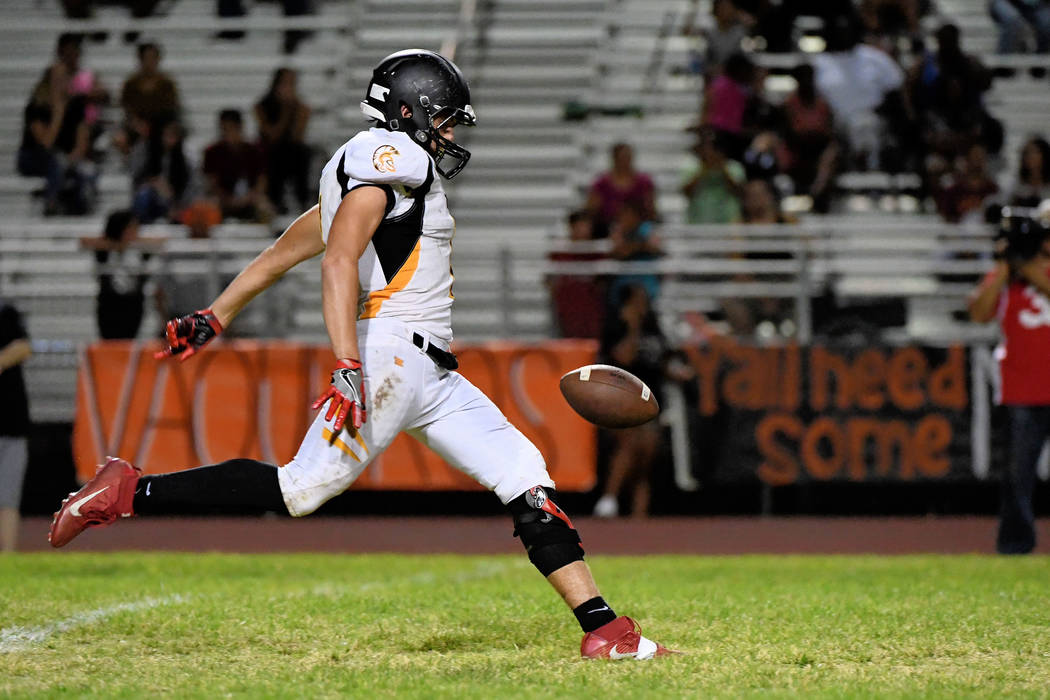 Peter Davis/Special to the Pahrump Valley Times Joshua Belcher punts the ball on Friday against Chaparral, something the Trojans had to do too many times against the Cowboys, who held the Trojans  ...