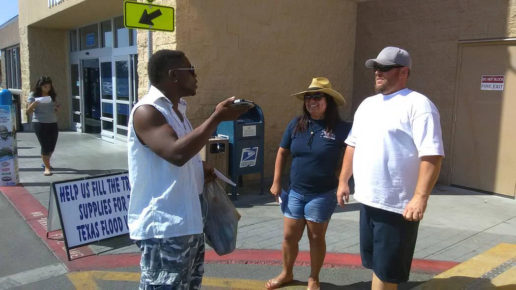 Selwyn Harris/Pahrump Valley Times Texas resident Cortney Washington thanks Trevor Maxwell and Jessica Cabrera on Saturday morning at Walmart. Washington was in town seeking employment, as Maxwell ...
