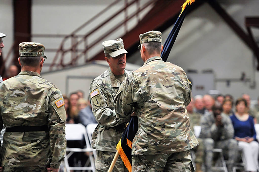 Special to the Pahrump Valley Times Brig. Gen. Zachary Doser hands the Nevada Army Guard flag to Command Sgt. Maj. Jared Kopacki, senior enlisted leader of the Nevada Army Guard, during a change o ...