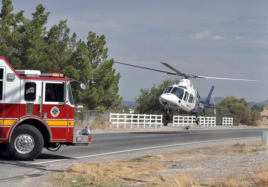Horace Langford Jr./Pahrump Valley Times  A landing zone was established on Blagg Road as Mercy Air 21 crews arrived just before 9:30 a.m. on Tuesday.