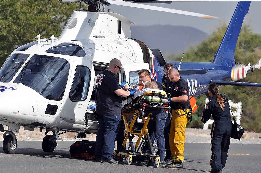 Horace Langford Jr./Pahrump Valley Times  Mercy Air 21 crews prepares the patient for flight to UMC Trauma in Las Vegas, following a late morning single-vehicle crash at Blagg and Harris Farm Roads.