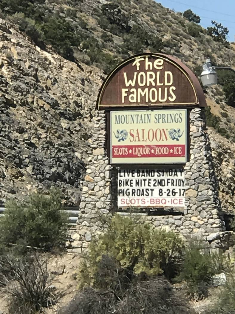 Jeffrey Meehan/Pahrump Valley Times Sign for the Mountain Springs Saloon at 19050 Nevada Highway 160 in Mountain Springs. The establishment offers a monthly barbecue from April to October, with th ...
