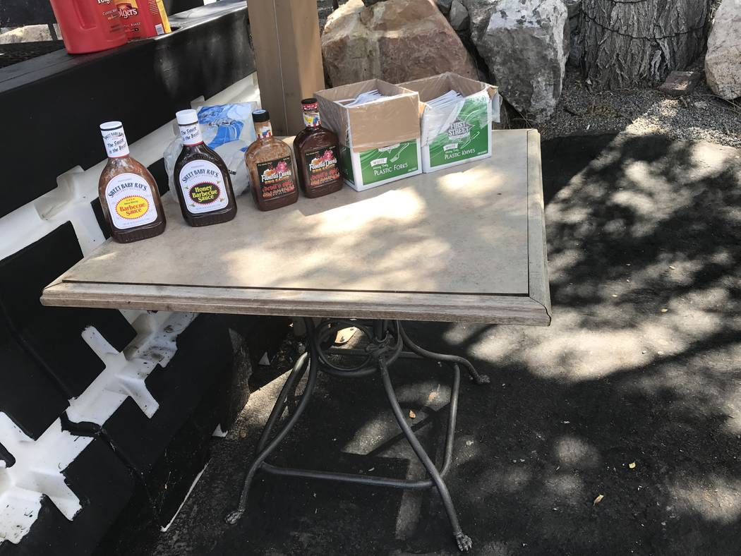 Jeffrey Meehan/Pahrump Valley Times The condiment table for event goers at the monthly Pig Roast in Mountain Springs on Aug. 26, 2017. Motorcyclists and motorists can stop in for a quick bite each ...