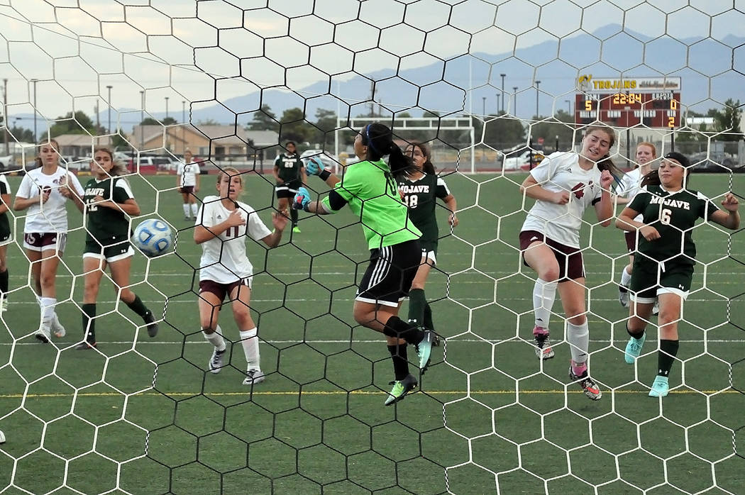 Horace Langford Jr./Pahrump Valley Times  Freshman Madelyn Souza scores the first goal of the second half with an assist by freshman Makayla Gent. She made the score 3-0. The Trojans won the game  ...