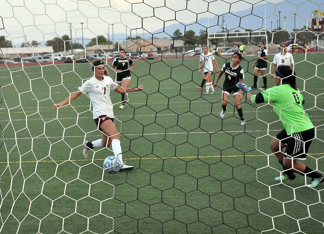 Horace Langford Jr./Pahrump Valley Times  Vaniah Vitto scores one of three for the night against Mojave. Vitto started the scoring against Mojave with her first goal 17 minutes into the game in th ...