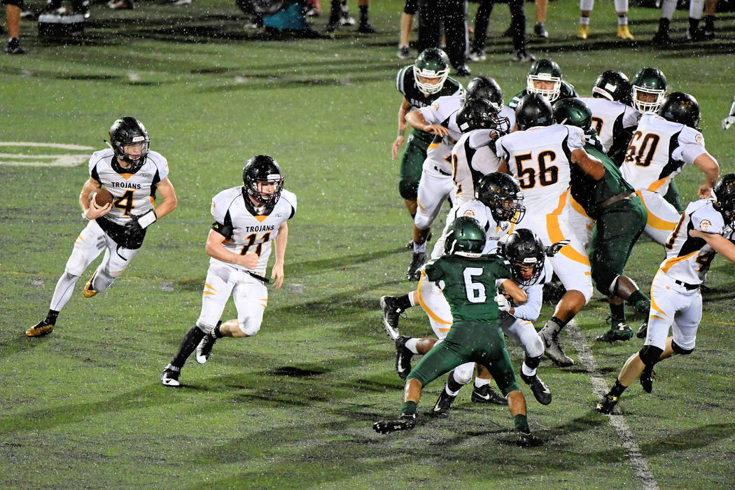 Senior quarterback Dylan Coffman found holes all night long in the Rancho defensive line. Here he is seen running toward a hole in the Rams line. His longest run of the night was 22 yards.