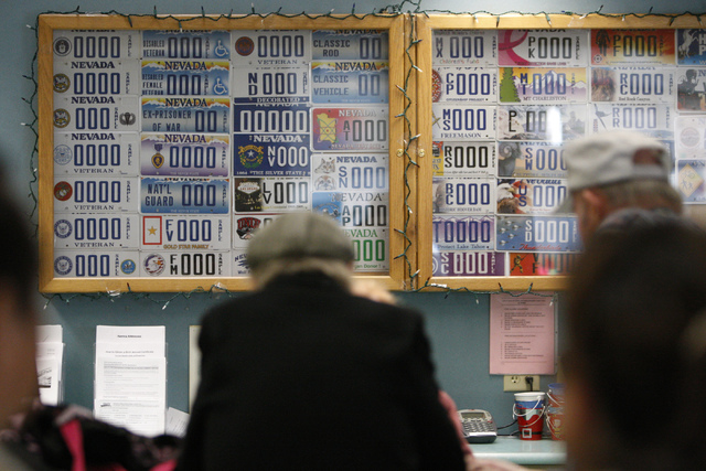 Specialty license plates decorate the wall at the DMV, 2701 E. Sahara Ave., in Las Vegas Tuesday, Dec 23, 2014. These plates must maintain registration of 1,000 plates, Air Force Thunderbirds, Air ...
