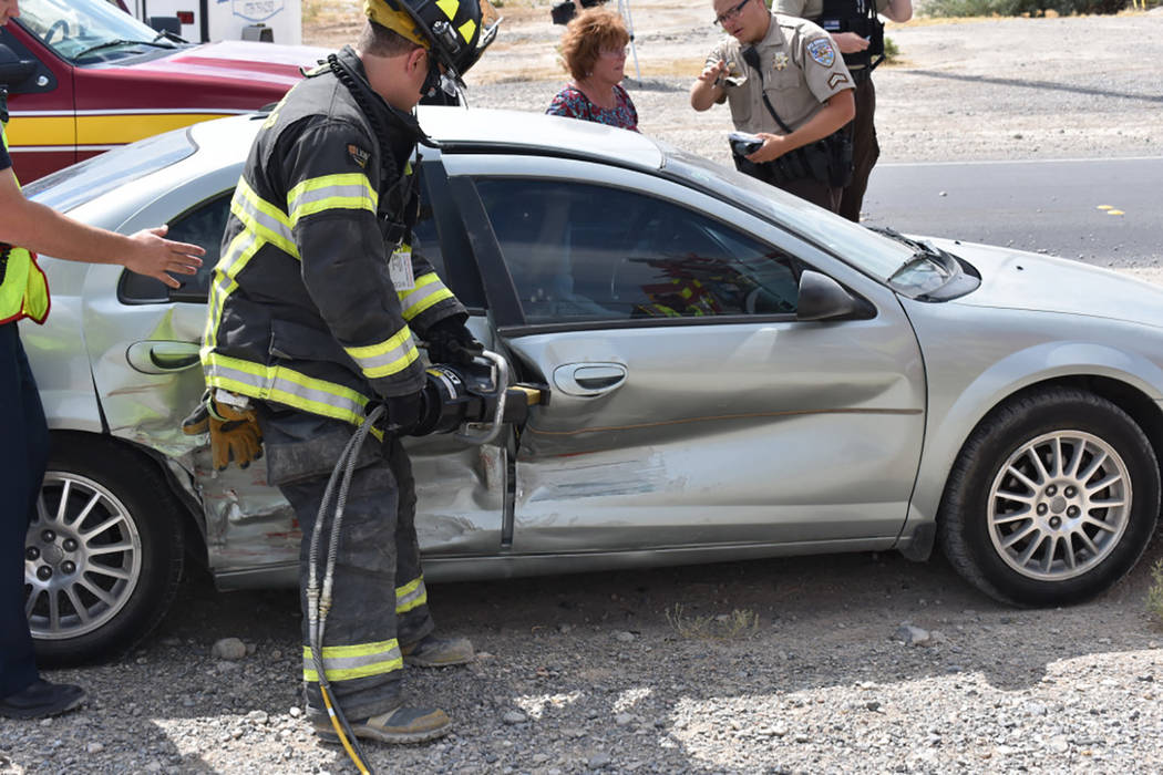 Special to the Pahrump Valley Times  A Pahrump Valley Fire and Rescue crew member works to free the mechanically entrapped driver, following a two-vehicle collision at Bell Vista Road and Leslie S ...