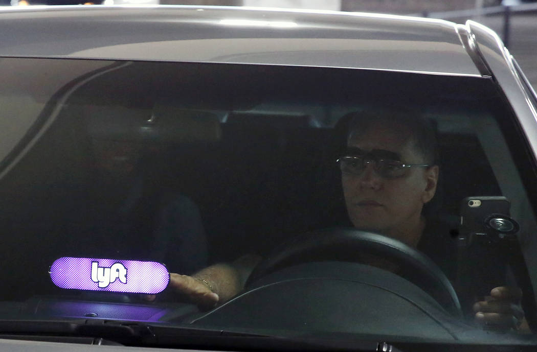 Bizuayehu Tesfaye/Las Vegas Review-Journal A driver displaying Lyft sign on his dashboard picks up his passenger from McCarran International Airport at Terminal 1 on Thursday, June 1, 2017, in Las ...