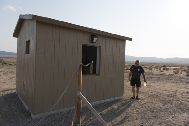 Larry Levy, fire chief for the Southern Inyo Fire Protection District, walks around the shed for a potable water vending machine in Tecopa, Calif. on June 21, 2016. The vending machine went into o ...