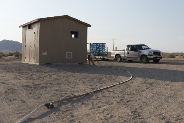 A truck hauling jugs of potable water sits next to the shed for a clean water vending machine in Tecopa, Calif., on June 21, 2016. (Las Vegas Review-Journal)