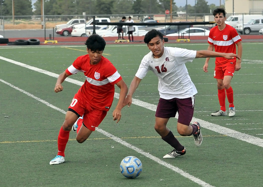 Horace Langford Jr./Pahrump Valley Times  Trojans junior soccer player Eric Toomer tries to get control of the ball against Western on Monday night.  The Trojans had problems controlling the ball  ...
