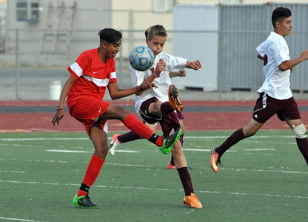 Horace Langford Jr./Pahrump Valley Times Trojans junior player Jose Chavez fights for the ball against Western on Monday night. Western dominated the boys soccer game on Monday.