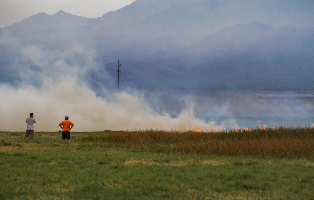 Nancy Good Special to the Pahrump Valley Times Fire crews from Pahrump Valley Fire-Rescue fought a brush fire that spread across 27 acres in Tecopa on Sept. 11, 2017, which was thought to be cause ...