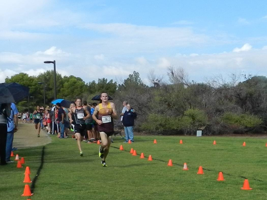 Special to the Pahrump Valley Times Trojans runner Bryce Odegard crosses the finish line in second place (15:29) at the Larry Burgess Invitational in Las Vegas.