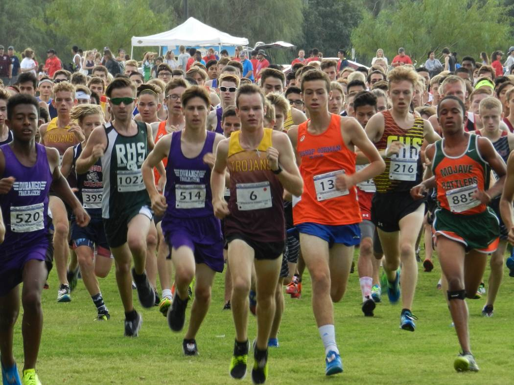 Special to the Pahrump Valley Times Trojans senior cross-country runner Bryce Odegard, (6), can clearly be seen in the middle at the head of the pack on Saturday's Larry Burgess Invitational at  ...
