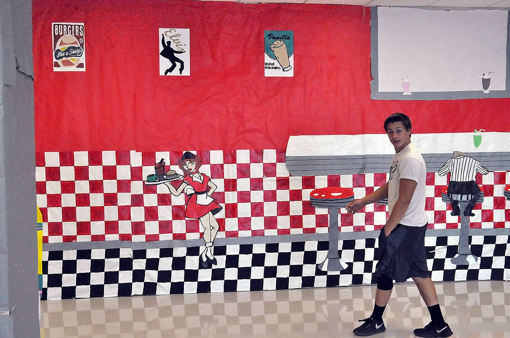 Horace Langford Jr./Pahrump Valley Times  Is this a fifties diner or Pahrump Valley High School. At first glance it sure looks like a diner. The high school decorated its walls in the halls for ho ...