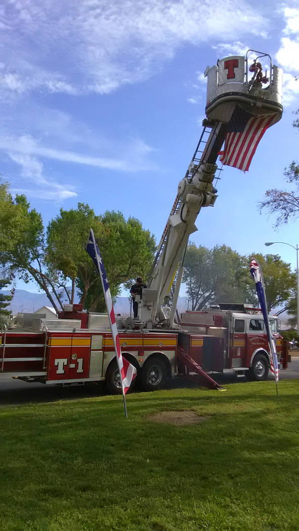 Selwyn Harris/Pahrump Valley Times Pahrump Fire Chief Scott Lewis brought along the department's Tower Ladder One fire truck to both 9/11 remembrance ceremonies on Monday. That particular appara ...