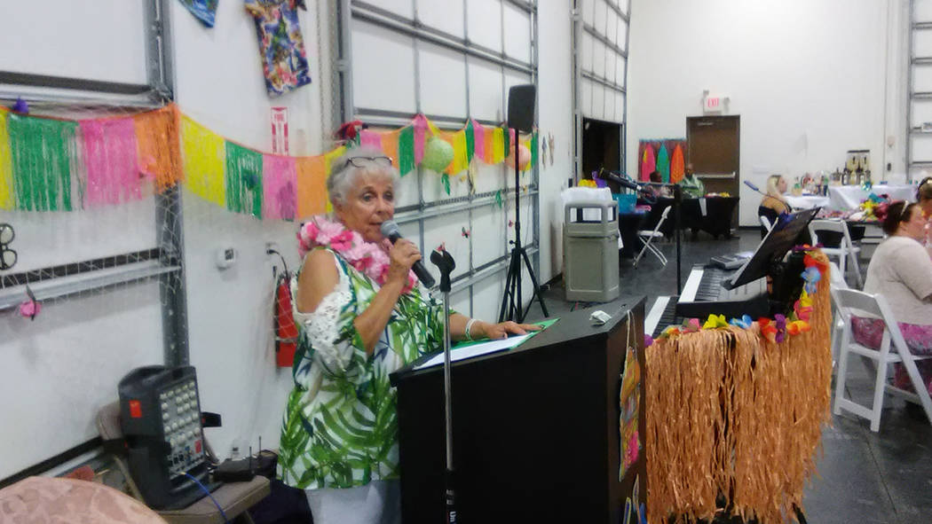 Selwyn Harris/Pahrump Valley Times  Casa Executive Director Willi Baer addresses the audience during the annual luau fundraiser last Saturday.