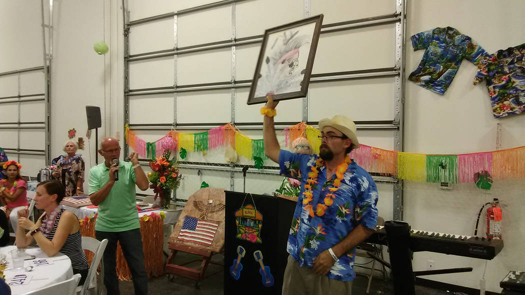 Selwyn Harris/Pahrump Valley Times  Auctioneers Ski Censke, left and Ron Gipson take bids during the ever-popular auction at the annual Casa Luau fundraiser. All told, the auction grossed upwards  ...