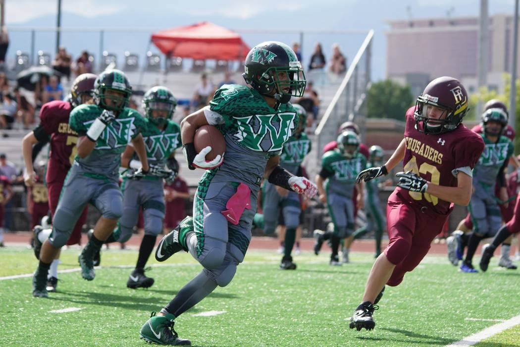 Jay Amaya runs for some big yards for the Pahrump Warriors against Faith Lutheran. The team beat the Warriors 27-0.