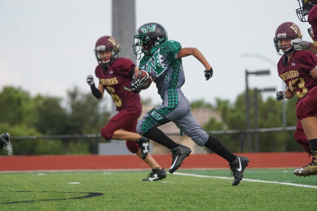 David Cook/Special to the Pahrump Valley Times  Makoa Batongbacal, receiver for the Pahrump Warriors, takes the ball down field against the Faith Lutheran Crusaders last weekend in his first game  ...