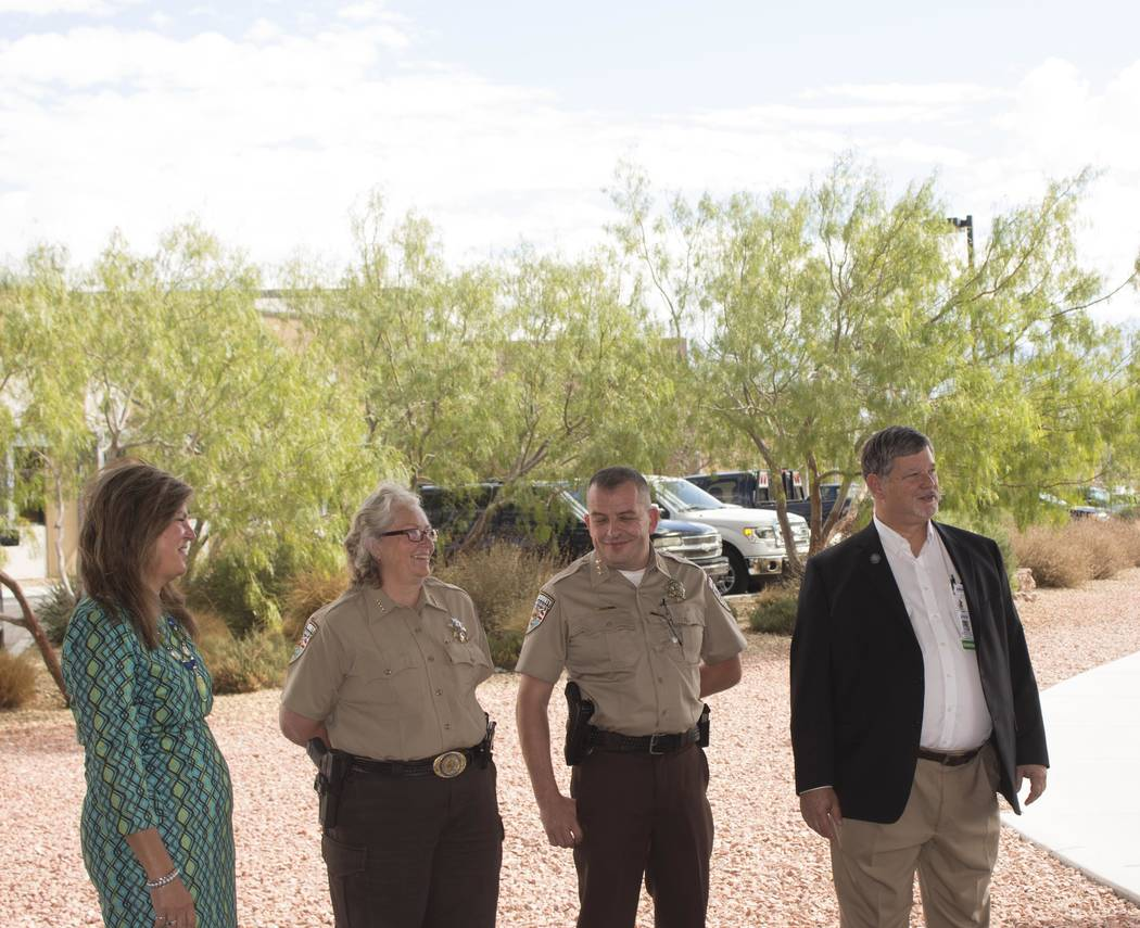 Jeffrey Meehan/Pahrump Valley Times Desert View Hospital CEO Susan Davila (left), Nye County Sheriff Sharon Wehrly (center), Nye County deputy sheriff (center) and Assemblyman James Oscarson stand ...