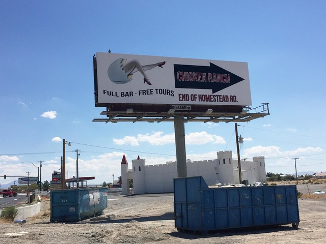 Pahrump Valley Times  A billboard advertising Chicken Ranch Brothel sits along Highway 160 in Pahrump. Brothel owner Dennis Hof said he had been approached by Ken Green, one of the owners of the h ...