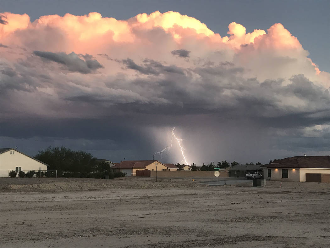 Heather Ruth/Pahrump Valley Times A look at lightning at sunset as seen in Pahrump on Wednesday evening in the Artesia area of town.