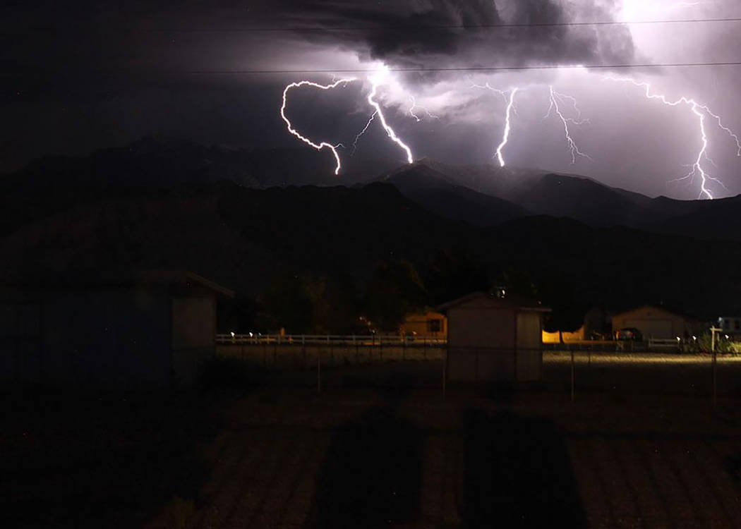 Josh Osborne/Special to the Pahrump Valley Times A look at the lightning display looking toward Mount Charleston on Wednesday night. This photo was taken from the Pahrump area as storms fired up b ...