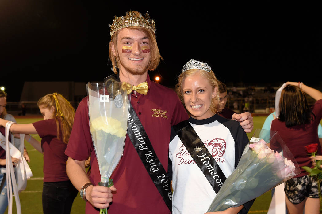 Homecoming king and queen, Adrian Grimaud and Torrie Martin, pose for a photo during the homecoming game at halftime. The homecoming dance was Saturday at the school.