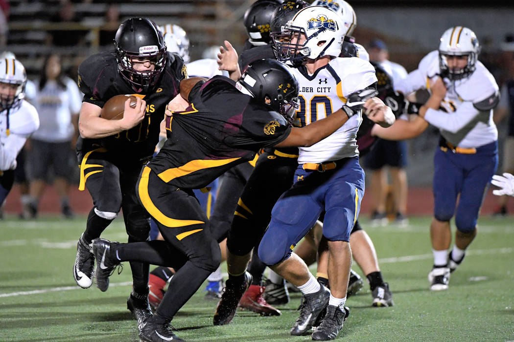 Peter Davis/Special to the Pahrump Valley Times Senior running back David Roundy follows his blockers on Friday night.