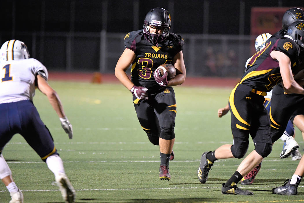 """Peter Davis/Special to the Pahrump Valley Times Nico Velazguez runs downfield for Pahrump Valley for the first time in two weeks. He was hurt during the Durango game. """"He had 67-yards rushing an ..."""