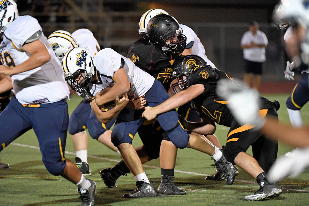 Peter Davis/Special to the Pahrump Valley Times Pahrump senior lineman Jeremy Albertson lowers the boom on a Boulder City runner on Friday night in front of a home crowd.