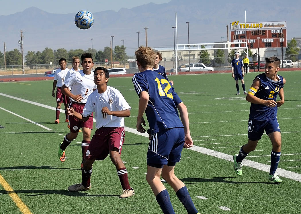 Horace Langford Jr./Pahrump Valley Times Trojans junior striker Christian Gonzalez uses his head to get control of the ball against the Eagles.
