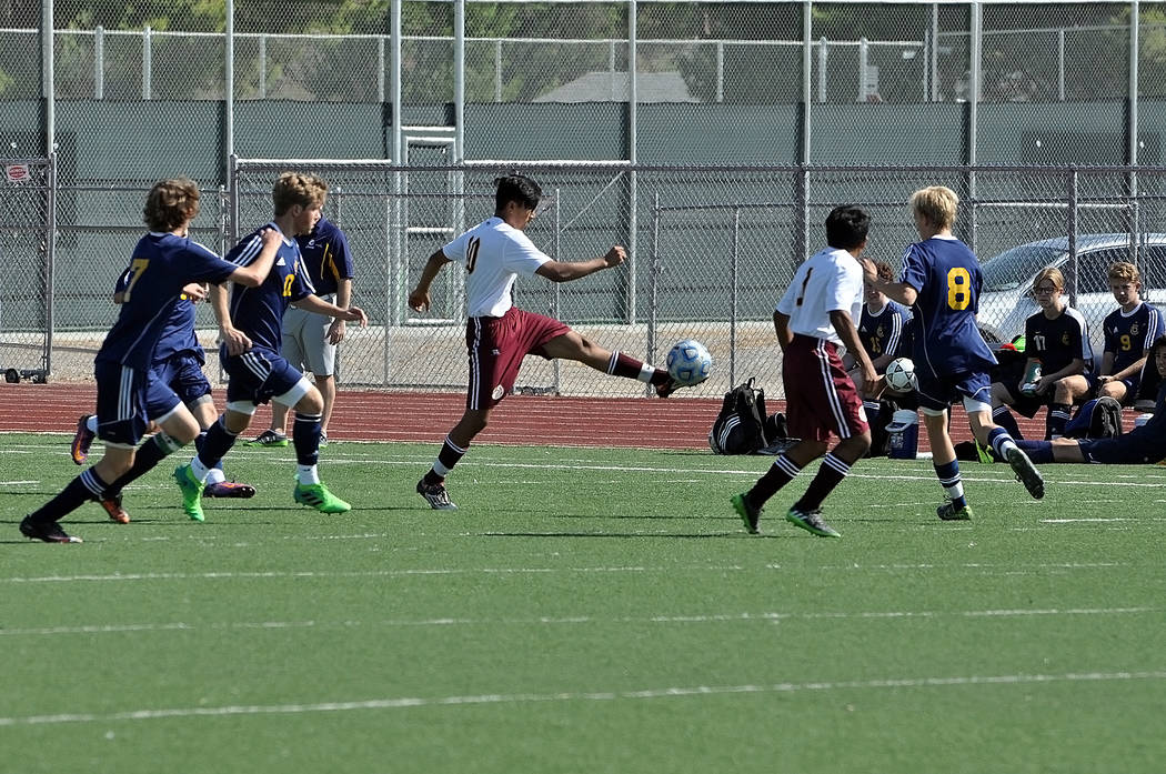 Horace Langford Jr./Pahrump Valley Times Pahrump Valley Junior midfielder Alvaro Garcia stops the ball midair on Saturday. The Trojans lost 2-1.