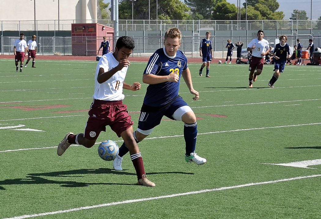 Trojans soccer junior striker Christian Gonzalez takes the ball downfield on Saturday against Boulder City. The Trojans faced a tough Desert Pines team on Tuesday afternoon.