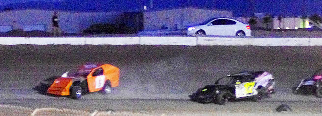 Vern Hee/Pahrump Valley Times Modified racer Rich Horibe (left) comes off turn two at the Pahrump Valley Speedway during this past summer. The Modified racers should be back in force for the two-d ...