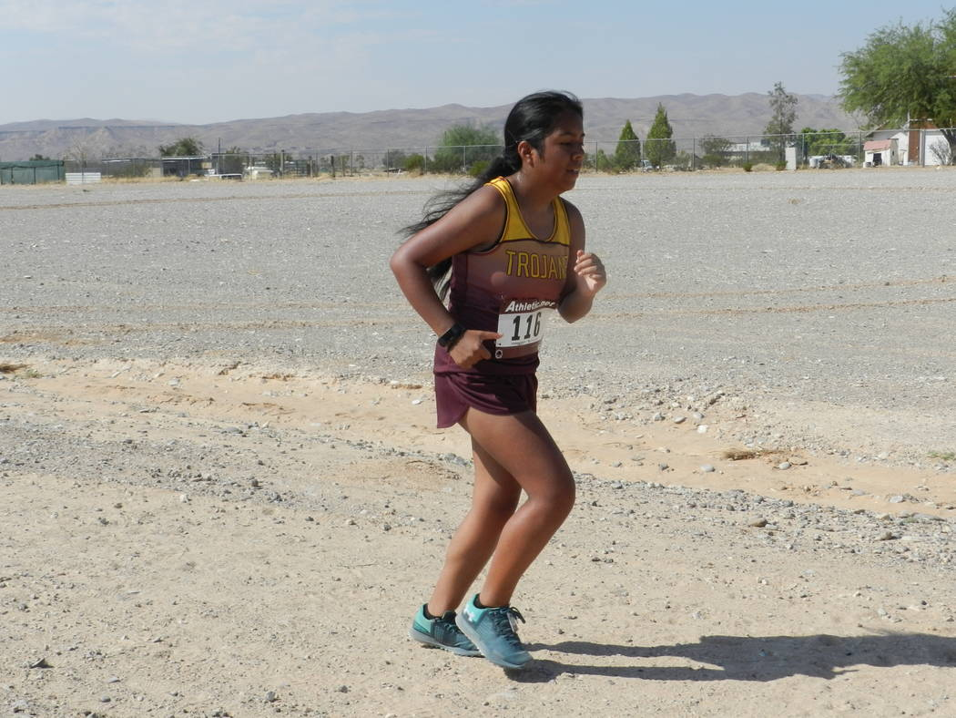 Special to the Pahrump Valley Times  Senior Carmen Changano runs her heart out at the Moapa Valley Invitational last week. The Trojans girls team came in second place.