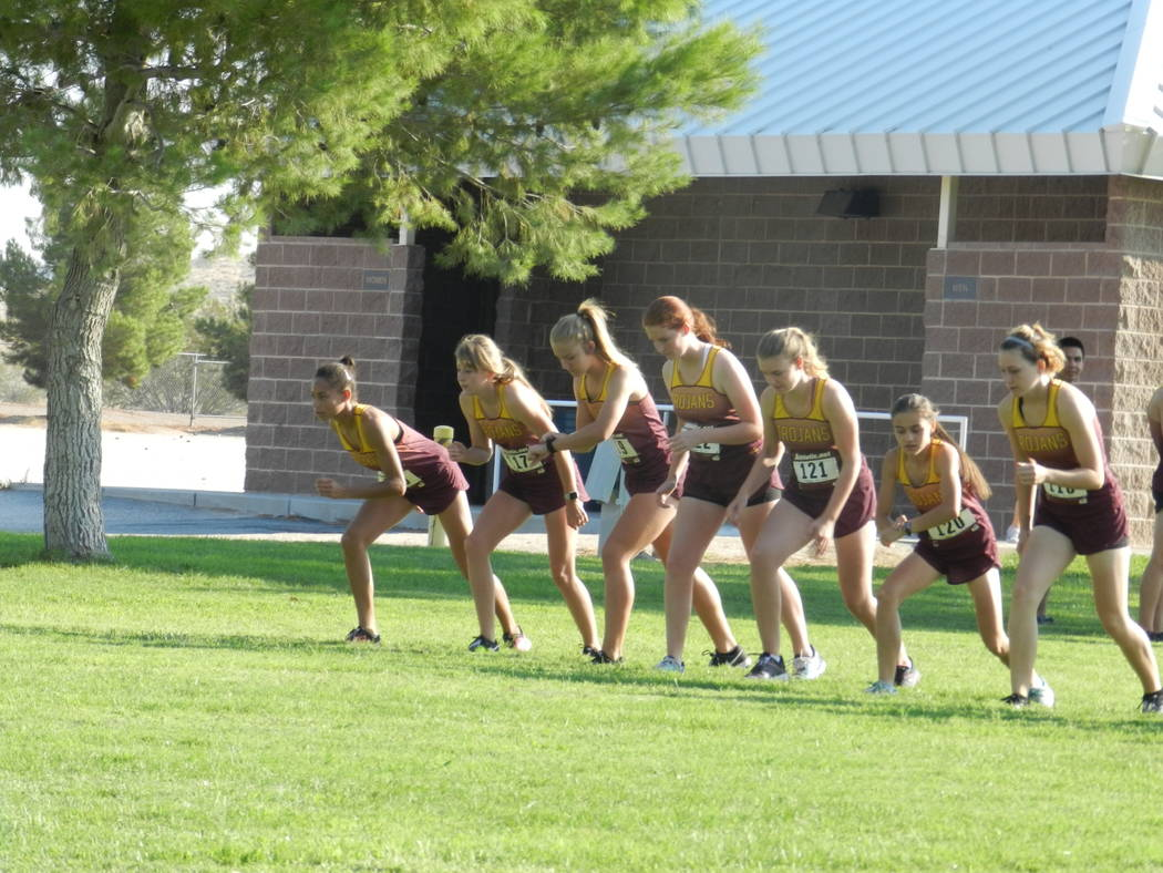 Special to the Pahrump Valley Times  Pahrump Valley's girls cross-country team lines up at the start of the Moapa Valley Invitational last weekend. The girls took second place.