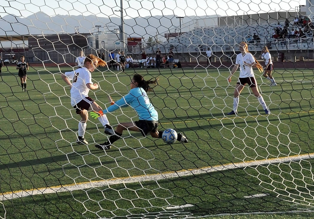 Horace Langford Jr./Pahrump Valley Times  Freshman Makayla Gent of the Trojans puts one past the goalie against Desert Pines in league action on Tuesday night. Gent scored three goals that game.