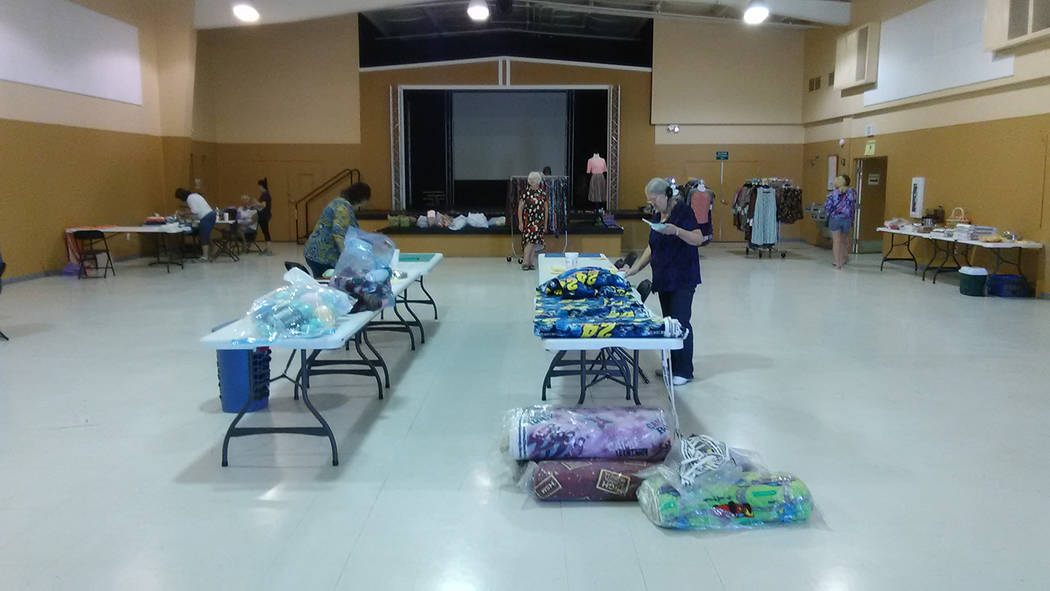 Selwyn Harris/Pahrump Valley Times  Officials with NyE Communities Coalition opened its large auditorium to allow volunteers to create their respective accessories for school students.