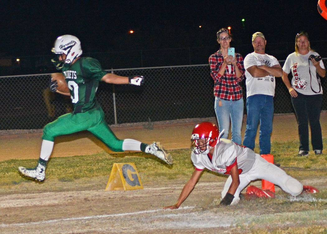 Richard Stephens/Pahrump Valley Times  Sophomore Beatty running back Fabian Perez scores a TD against Tonopah last Friday. Perez had 18 carries for 137 yards and he scored two TDs.